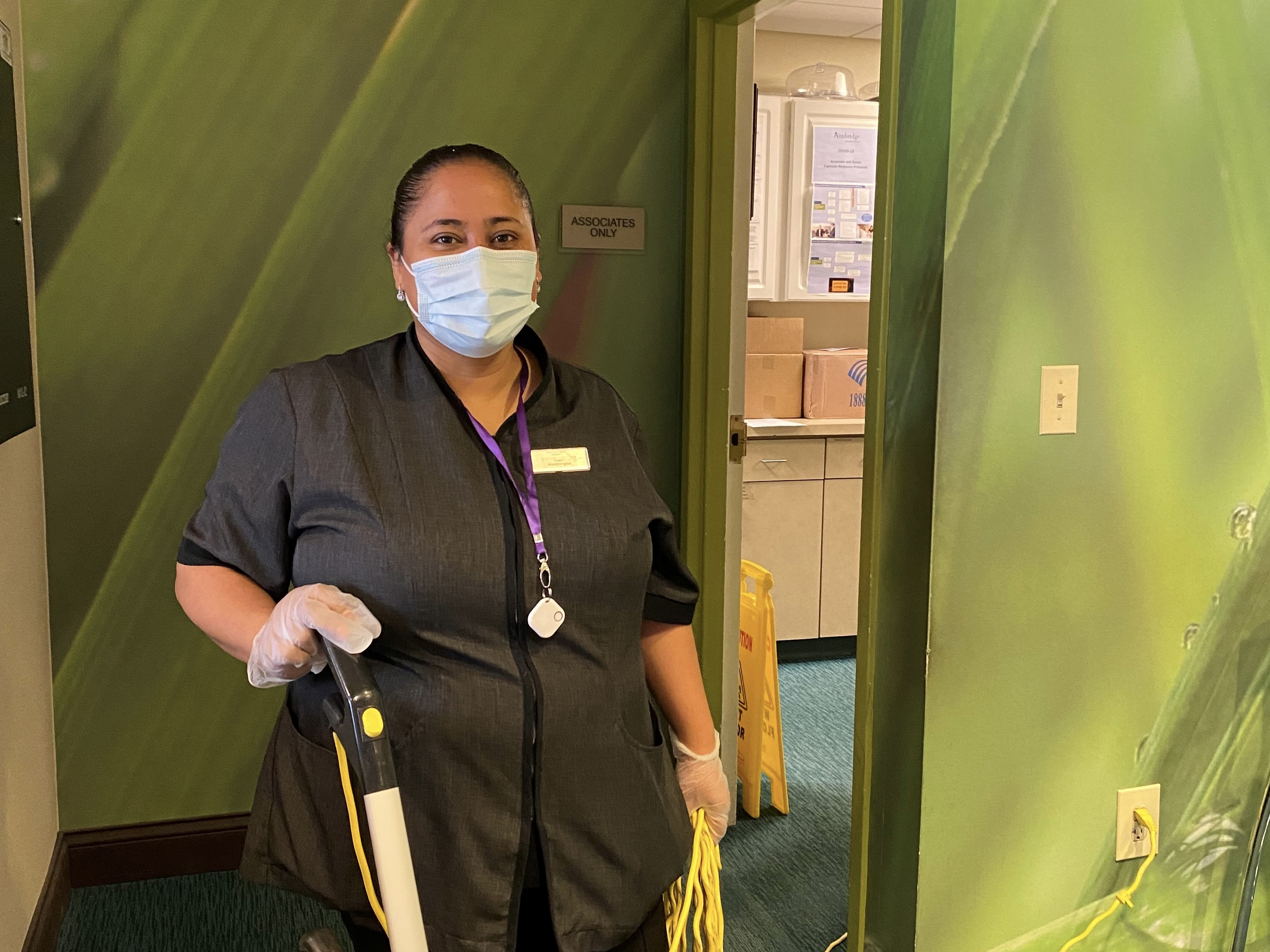 Maria, a housekeeper from one of our Chicago properties, wearing AlwaysOn.