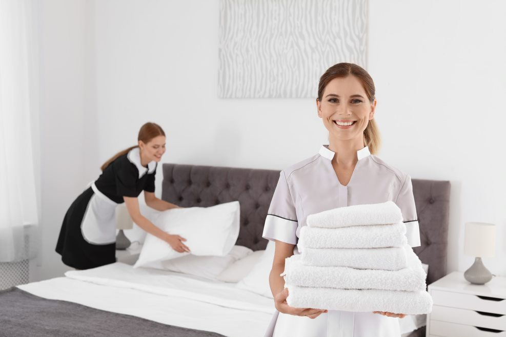 hotel-staff-cleaning-room